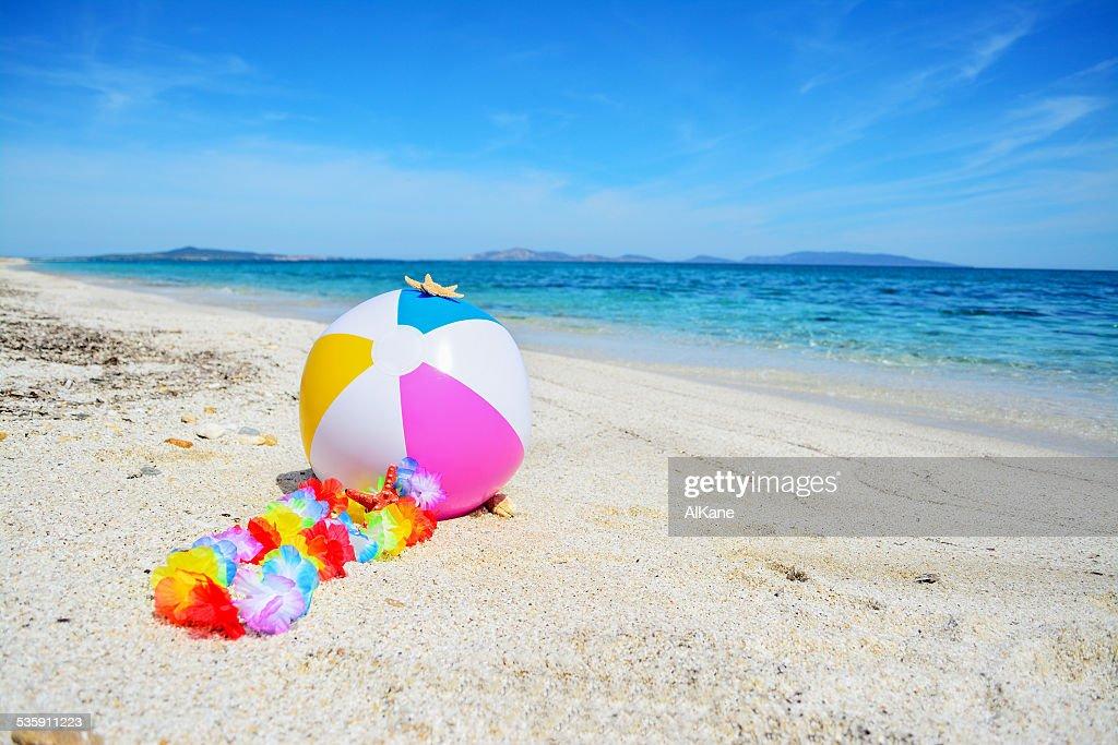 beach ball with hawaiian necklace : Stock Photo