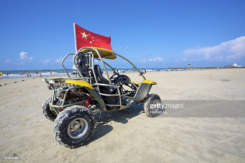Beach bike with a chinese flag on it : Stock Photo