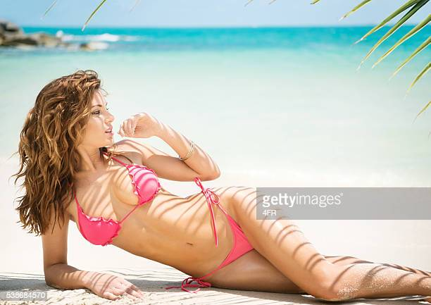 beach bikini beauty with palm tree textures on her skin - hot babe stockfoto's en -beelden