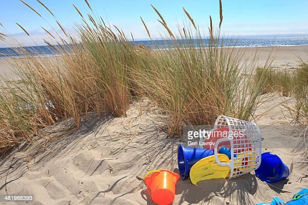 Beach buckets in sand