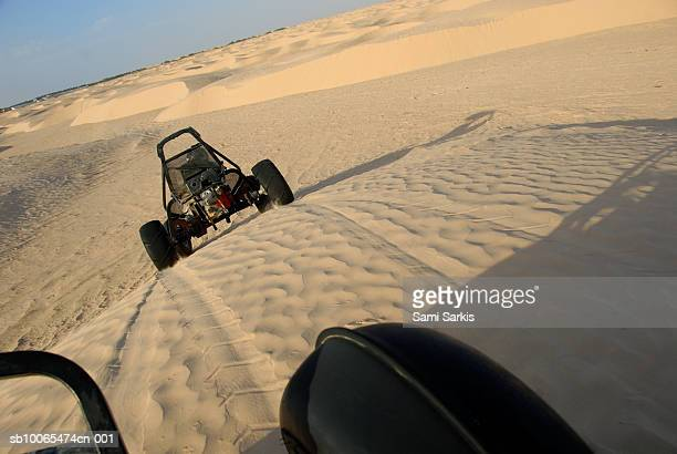 Beach buggies speeding across desert