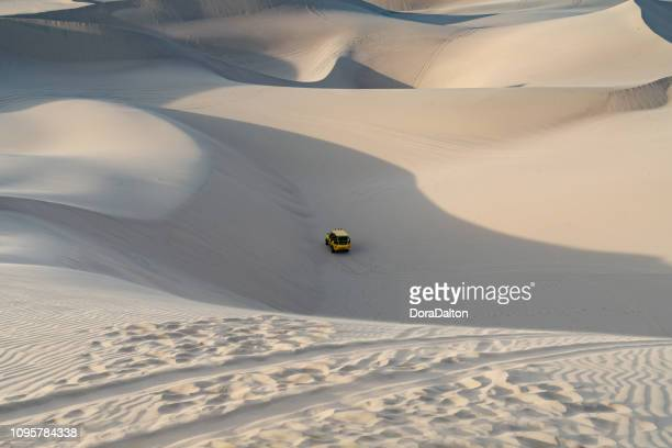 beach buggy on sand dunes in huacachina, peru - rally car racing stock pictures, royalty-free photos & images