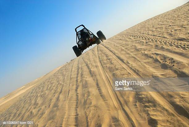Beach buggy speeding across desert