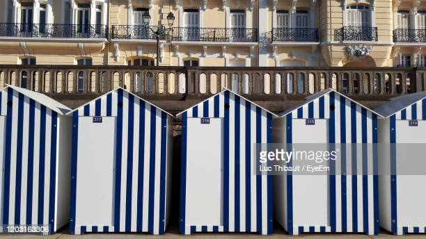 beach cabins against in city - calvados stock pictures, royalty-free photos & images