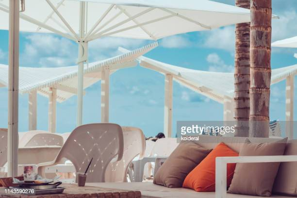beach cafeteria against blue sky - pavement cafe stock pictures, royalty-free photos & images
