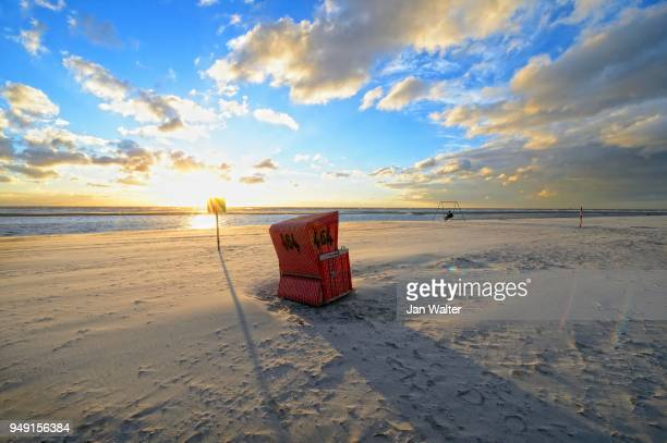 Beach chair in the back light at the beach of Langeoog, Ostfriesische Insel, Germany