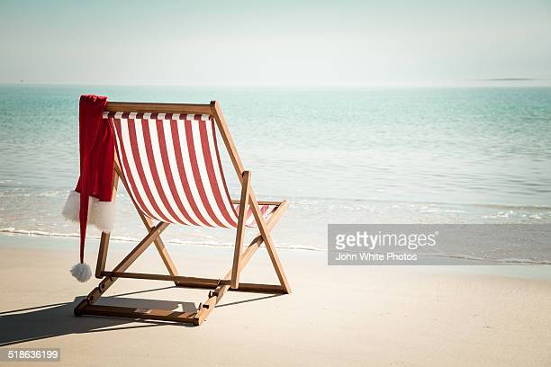 Beach chair with santa hat.
