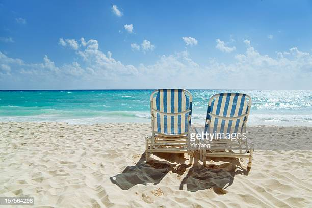 beach chairs along the caribbean sea - playa del carmen stock pictures, royalty-free photos & images