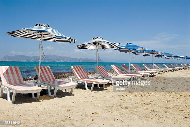 beach chairs and parasols