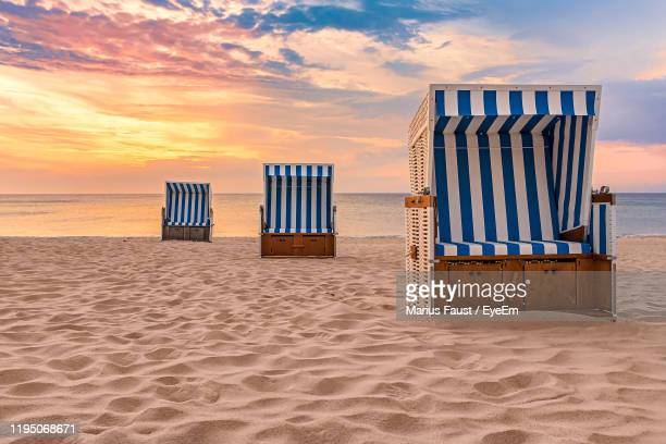 beach chairs and sunset on the island sylt - north sea stock pictures, royalty-free photos & images