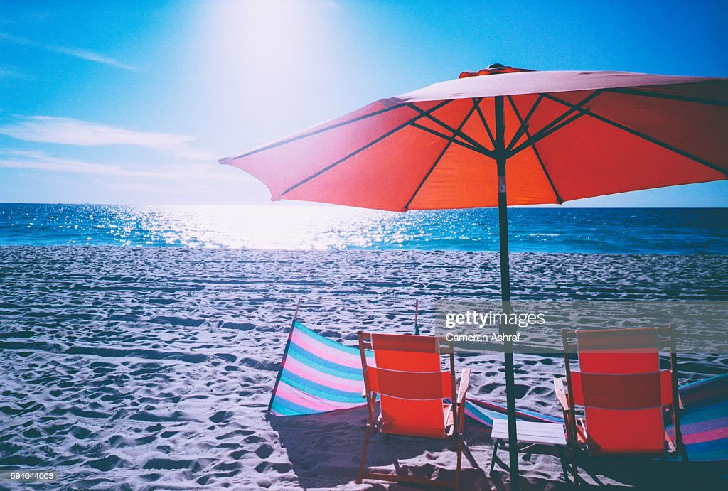 Beach Chairs And Umbrella On Santa Monica Stock Photo
