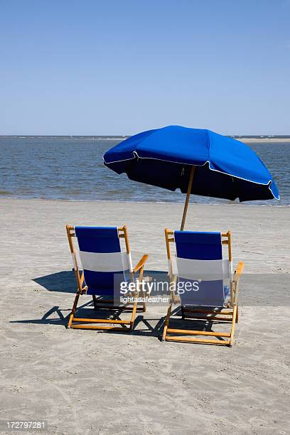 beach chairs and umbrella - brunswick georgia stock pictures, royalty-free photos & images
