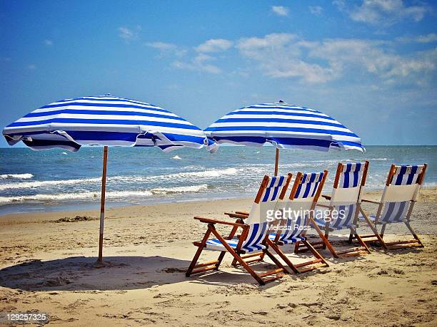 beach chairs and umbrellas in ocean city - cape may stock pictures, royalty-free photos & images