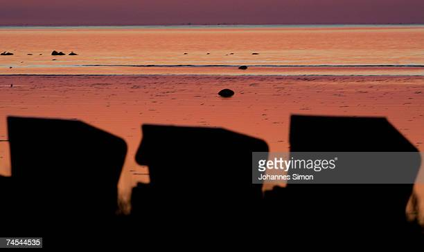 Beach chairs are silhouetted against the Baltic Sea during sunset on June 11 at the island of Poel near Wismar Germany Meteorologists predict hot and...