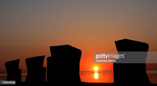 Beach chairs are silhouetted against the Baltic Sea on June 11 at the island of Poel near Wismar Germany Meteorologists predict hot and sunny weather...