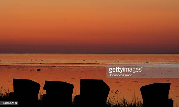Beach chairs are silhouetted against the Baltic Sea on Junel 11 at the island of Poel near Wismar Germany Meteorologists predict hot and sunny...