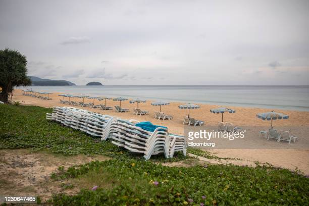 Beach chairs are stacked at a deserted Karon Beach in Karon, Phuket, Thailand, on Sunday, Dec. 20, 2020. The tepid response to Thailands highly...