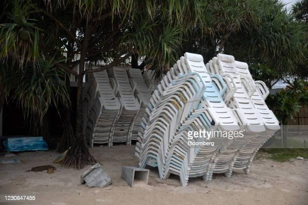 Beach chairs are stacked at Patong beach in Patong, Phuket, Thailand, on Sunday, Dec. 20, 2020. The tepid response to Thailands highly publicized...