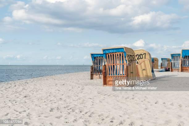 beach chairs in the sun on the beach. (baltic sea) - schleswig holstein stock-fotos und bilder