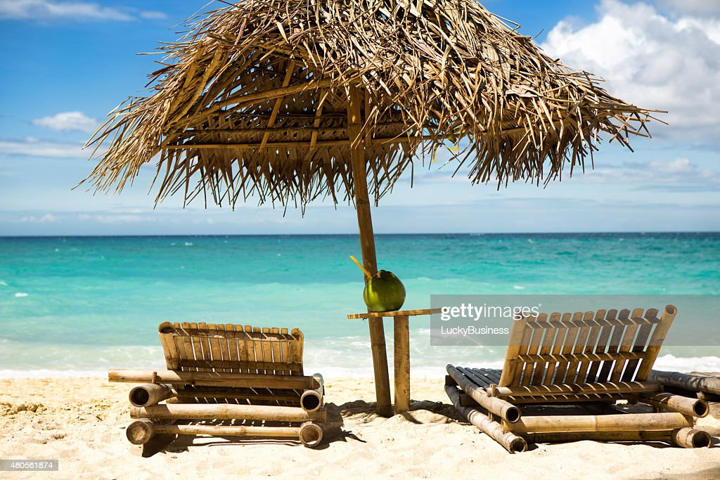 Beach chairs on beautiful sand coast : Stock Photo