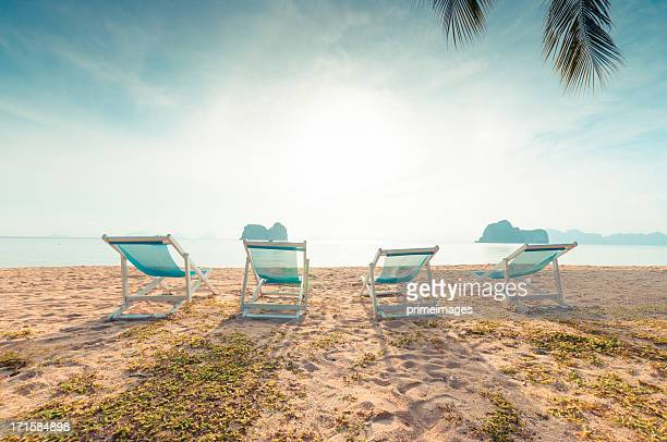 Beach chairs on perfect tropical white sand