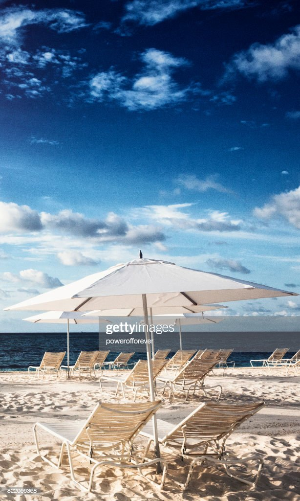 Beach chairs on the sand in the Bahamas : Stock Photo