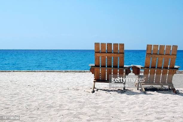 Beach Chairs on White Sand Overlooking Caribbean
