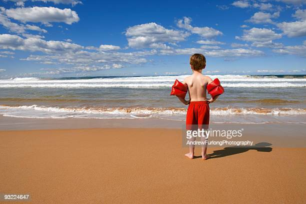beach child standing - armband stock pictures, royalty-free photos & images