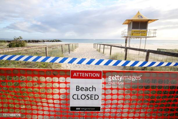 A 'Beach Closed' sign is seen at Coolangatta beach on April 08 2020 in Gold Coast Australia A number of major Gold Coast beaches have been closed...