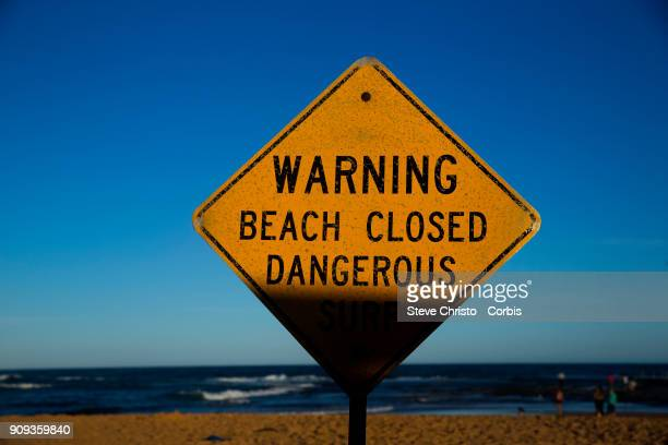 Beach Closed sign warning swimmers of the dangerous surf conditions during king tides at Mona Vale on January 18 2018 in Sydney Australia