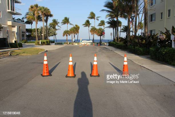 beach closure during social distancing rules due to coronavirus - marie lafauci stock pictures, royalty-free photos & images