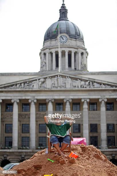 Beach coordinator Edward Mellors poses as he takes a break from building the UK's largest city centre beach on July 16 2009 in Nottingham England Up...