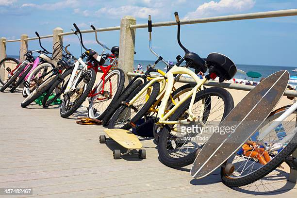 Beach cruisers and skateboards on beach boardwalk
