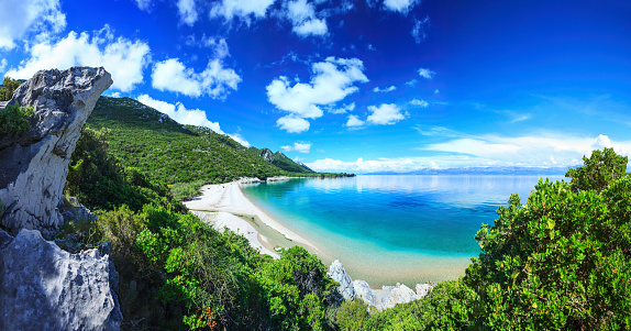 Beach, crystal clear water in Adriatic Sea and Green Mountains 656470284