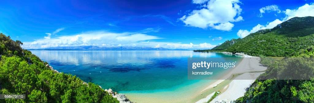 Beach, crystal clear water in Adriatic Sea and Green Mountains : Stock Photo