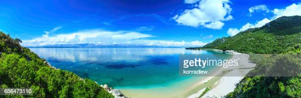 Beach, crystal clear water in Adriatic Sea and Green Mountains