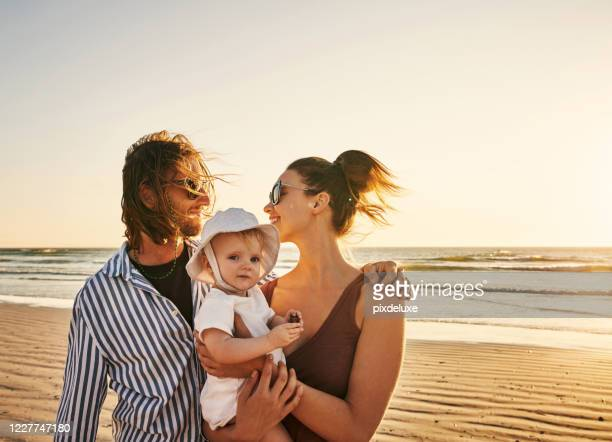 beach days put the quality in quality time - infant with water stock pictures, royalty-free photos & images