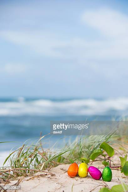 beach easter eggs - easter beach stock pictures, royalty-free photos & images
