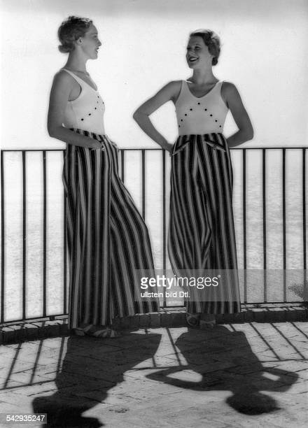 Beach fashion Two women in long striped trousers and white jersey 1933 Photographer Karl Schenker Published by 'Die Dame' 16/1933 Vintage property of...