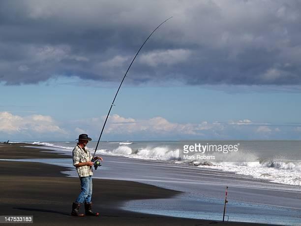 Beach fishing in New Zealand