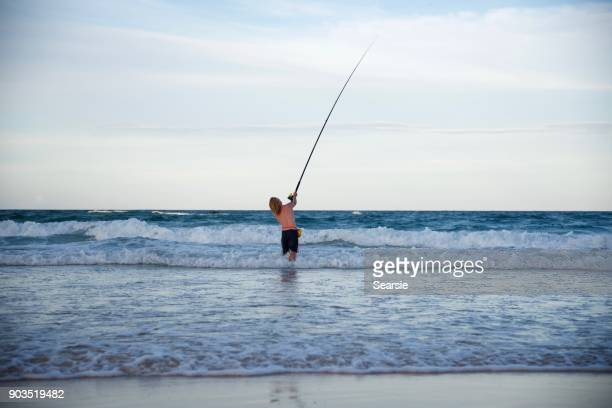 Beach fishing on Fraser island at sunset