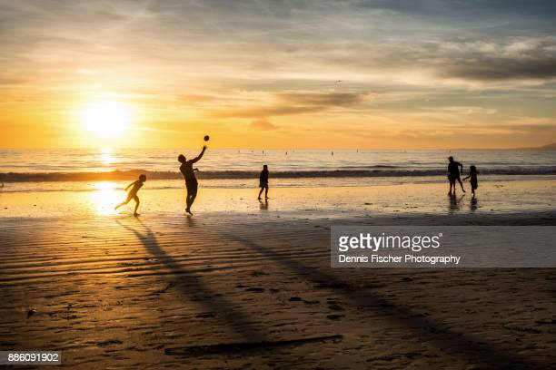 Beach football during sunset in Los Angeles