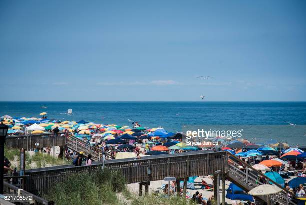 beach full of vacationers at bethany beach - bethany beach stock photos and pictures