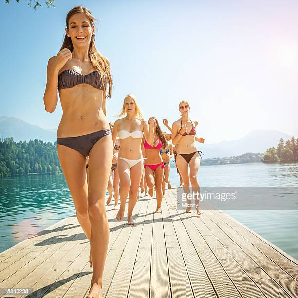 Beach Girls Running over Jetty