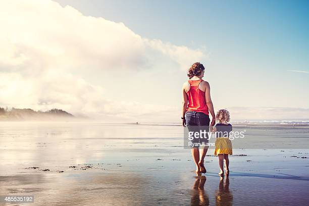 beach girls walking hand in hand - washington state stock pictures, royalty-free photos & images