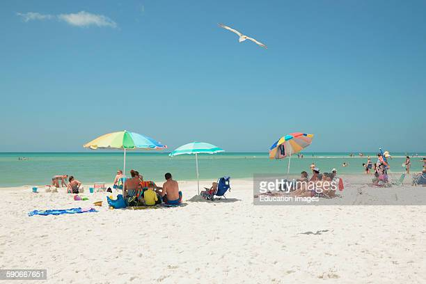 Beach goers and sun worshipers enjoy the sand and the water of Siesta Key Beach in Sarasota Florida Siesta Key has been name to top beach in the US
