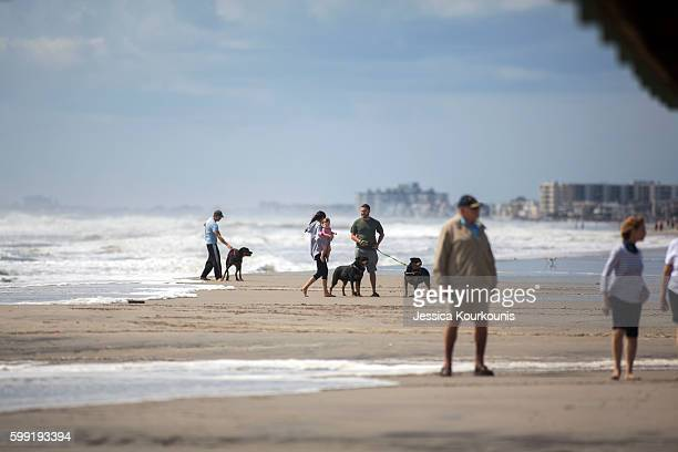 Beach goers continue to come out as high winds from tropical storm Hermine make her way north towards the East coast on September 4 2016 in Margate...