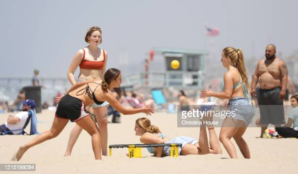 Beach goers enjoy a sunny day at Hermosa Beach while social distancing from others, including family members, from front left, Emily, Caroline,...