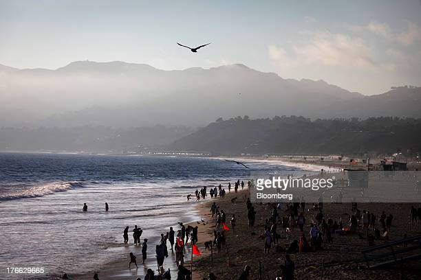 Beach goers enjoy the Pacific Ocean near a lifeguard tower north of the Santa Monica Pier in Santa Monica California US on Monday Aug 5 2013 Overall...