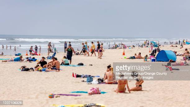 Beach goers enjoy the sun and and sand near the Huntington Beach Pier in Huntington Beach on Thursday April 30 the day before Gov Gavin Newsom is...